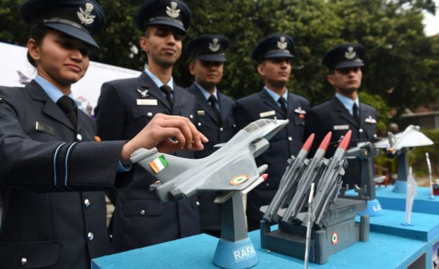 Members of the Air Force contingent pose with a mockup of the Indian Air Force tableaux for the Republic Day Parade featuring the Rafale fighter jet.