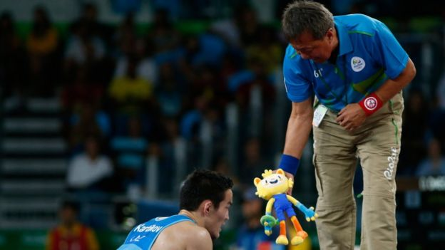 Doszhan Kartikov of Kazakhstan is shown Vinicius by his coach