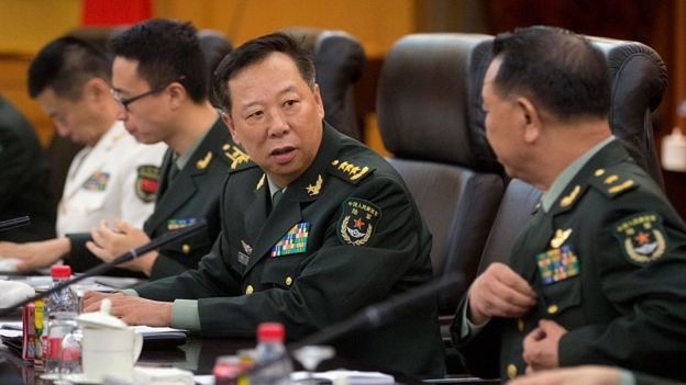 China's People's Liberation Army (PLA) General Li Zuocheng (C) speaks during a meeting with unseen US Army Chief of Staff General Mark Milley at the Bayi Building in Beijing on 16 August 2016.