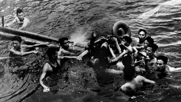 A photo taken 26 October 1967 shows US Navy Airforce Major John McCain (C) being rescued from Hanoi's Truc Bach lake by several Hanoi residents after his Navy warplane was downed by Northern Vietnamese army during the Vietnam War.