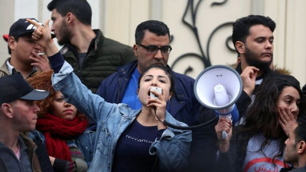 A demonstrating graduate shouts slogans during protests against rising prices and tax increases, in Tunis, Tunisia January 9, 2018
