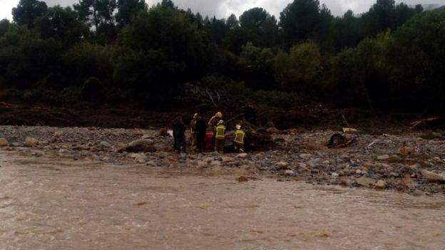 Catalan police were trying to find two missing people after an empty car was found in the river