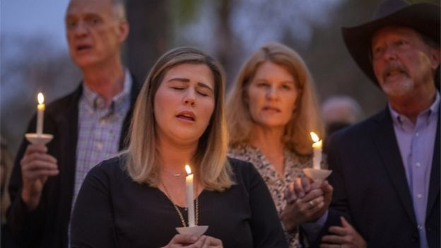 Rancho Bernardo Community Presbyterian Church members hold a candlelight vigil for victims of the synagogue shooting