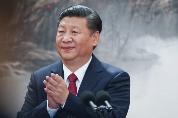 Chinese President Xi Jinping speaks at the podium during the unveiling of the Communist Party