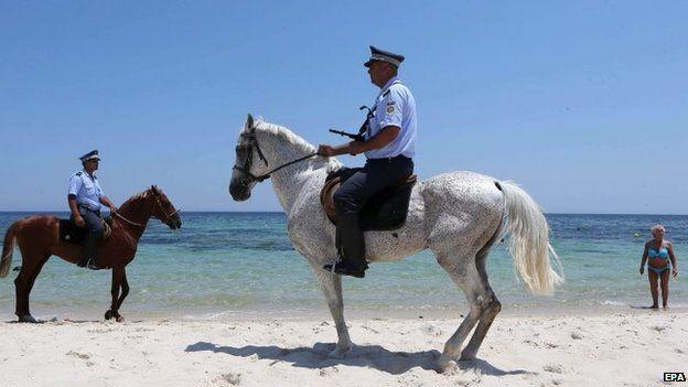 Police patrolling beach near scene of 26 June attack