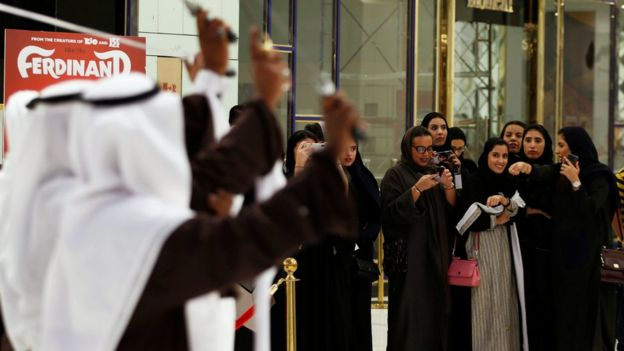 Saudi women attend the opening of a cinema in Saudi Arabia