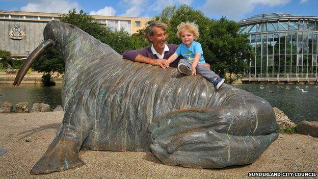 Visitors enjoy the walrus sculpture in Sunderland