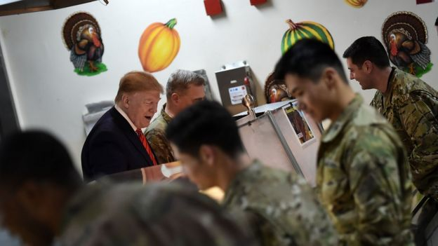 US President Donald Trump serves Thanksgiving dinner to US troops at Bagram Air Field