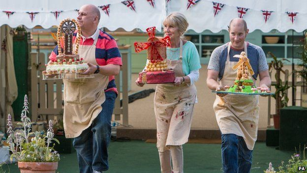 The 2014 finalists of the Great British Bake Off presenting their showstoppers