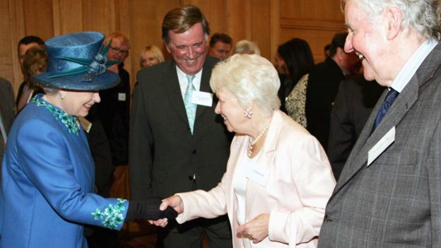 June Whitfield shakes hands with the Queen
