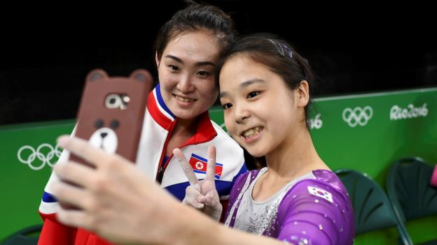 Lee Eun-Ju of South Korea takes a selfie with Hong Un Jong of North Korea, during Gymnastics training at the Rio Olympic Arena, Rio de Janeiro, Brazil, August 2016