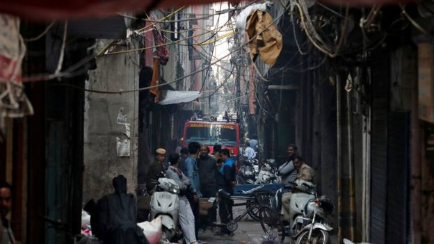 A fire engine is seen down an alleyway