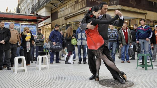 Fanny and Fabio, a couple of tango street dancers, perform in the intersection of Florida and Lavalle streets in downtown Buenos Aires