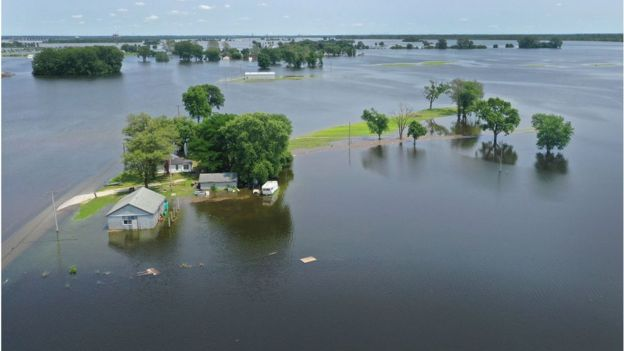 Mississippi floodwaters surround a Missouri home