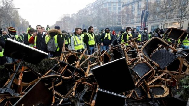 Protesters in Paris man a barricade on the Champs-Elysees, 24 November, 2018