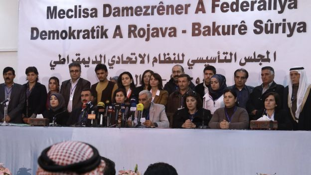 Delegates from Syrian Kurdish, Arab, Assyrian and other parties take part in a conference in Rumeilan at which a federal system in Kurdish-controlled northern regions was announced (17 March 2016)