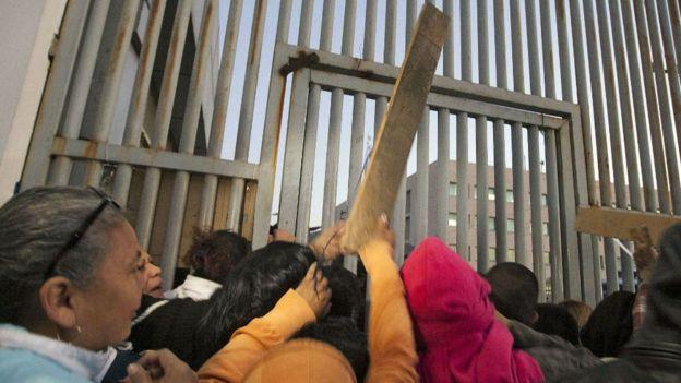 Sticks thrown at gate outside Topo Chico prison. 11 Feb 2016