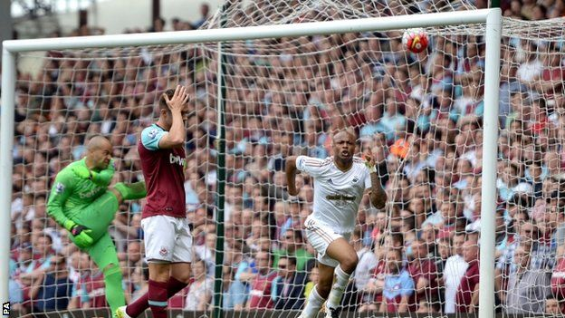 Andre Ayew celebrates as Darren Randolph and Aaron Cresswell show their dejection