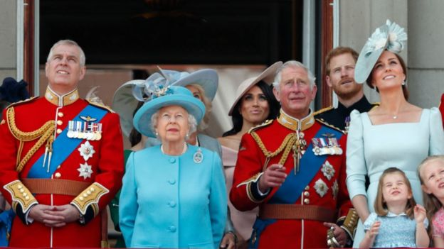 The British royal family watches a military air show from the balcony of Buckingham Palace