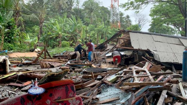 Indonesian residents gathering their possessions near Anyer Beach