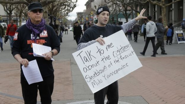 Protesters hold signs while talking to students and others on the University of California, Berkeley, campus on 2 February, 2017.