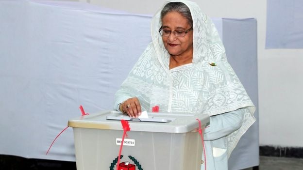 ed1a8d513fb Prime Minister Sheikh Hasina casts her vote in the morning during the  general election in Dhaka