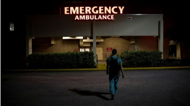 a resident ER doctor at Holy Cross Hospital, arrives at work for the start of his shift