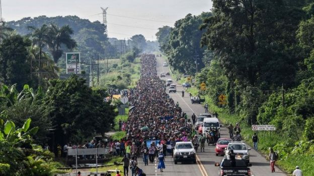 Honduran migrants take part in a caravan heading to the US on the road linking Ciudad Hidalgo and Tapachula, Chiapas state, Mexico on October 21, 2018.