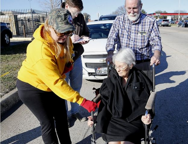 Dannetta Maldonado (left) helps Diana Richardson as she is pushed by her husband John Richardson after a shooting took place at West Freeway Church of Christ on December 29, 2019