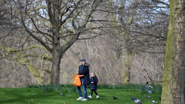 "Members of the Public walk round St James""s Park on March 21, 2020 in London, England"