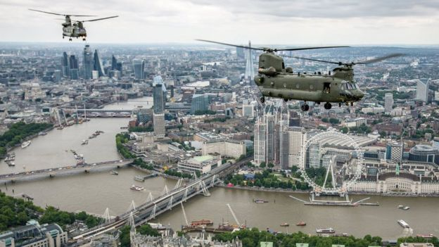 Military helicopters fly over London, heading for Buckingham Palace, to mark the centenary of the Royal Air Force in central London