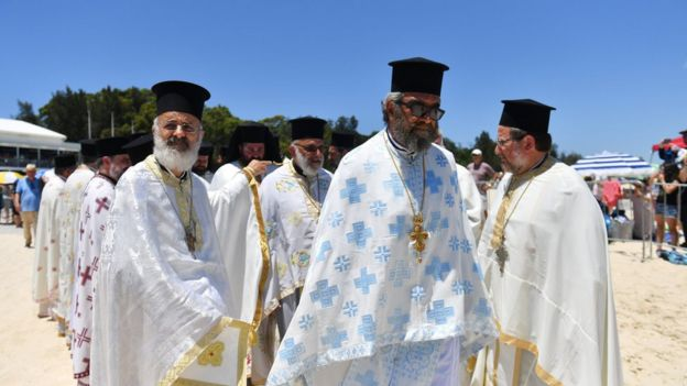 Greek Orthodox priests arrive for the start of the Festival of the Epiphany at Yarra Bay in Sydney, Australia, 07 January 2018