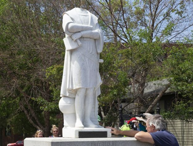 City employees inspect the decapitated statue of Christopher Columbus in Columbus Park in Boston, Massachusetts, 10 June 2020
