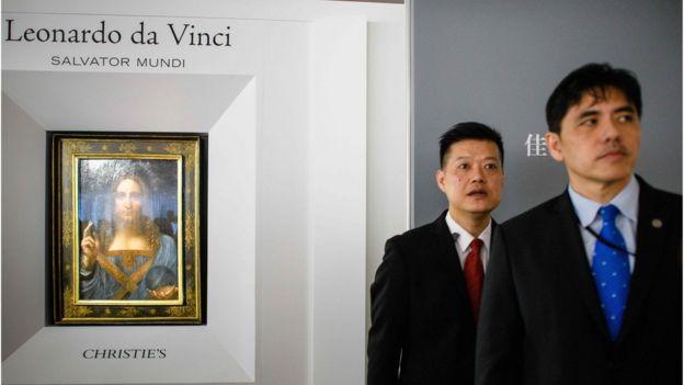李振成(右)曾在香港知名拍卖行工作。