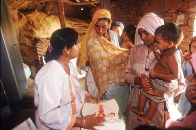 A doctor gives a speech on family planning in the village of Udaka
