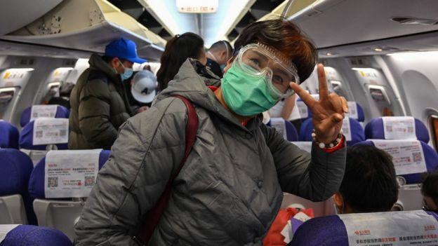 Pasajeros en un avión en Shanghái