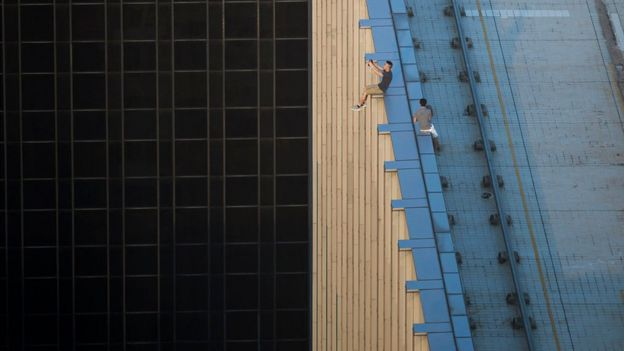 Men on the edge of a building