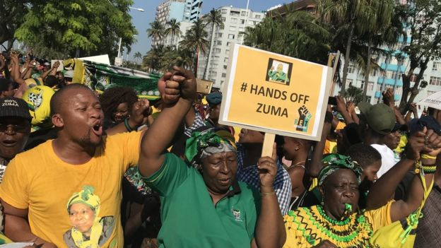 "Zuma supporters in Durban with a ""Hands off Zuma"" placard, 6 April 2018"