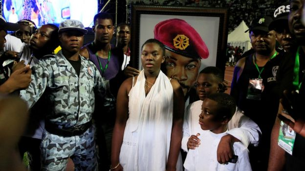 The children of late Ange Didier Houn, also known as DJ Arafat, attend a tribute ceremony