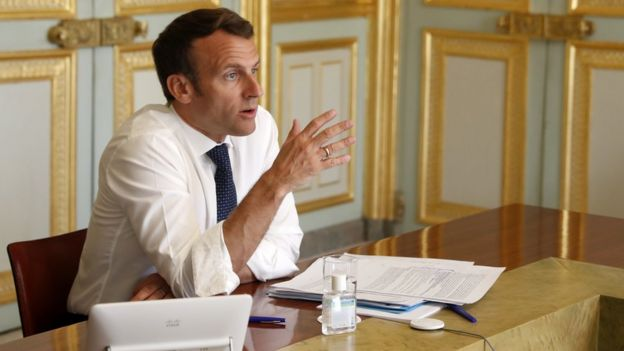 French President Emmanuel Macron attends a video conference at the Elysee Palace in Paris, April 16 2020
