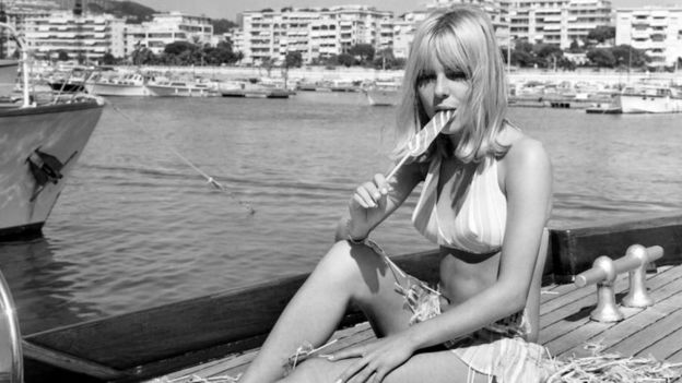 File pic shows French Singer France Gall eating a lollipop in Cannes on 10 August 1966