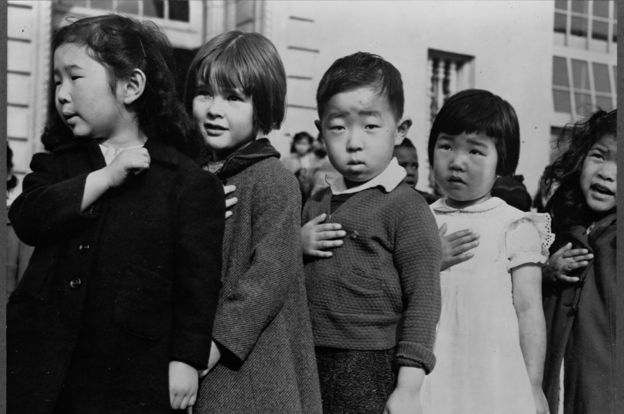 Japanese children doing the swearing of the flag in the USA  before being taken to detention camps together with their families.