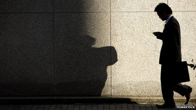 Man walking along in shadow