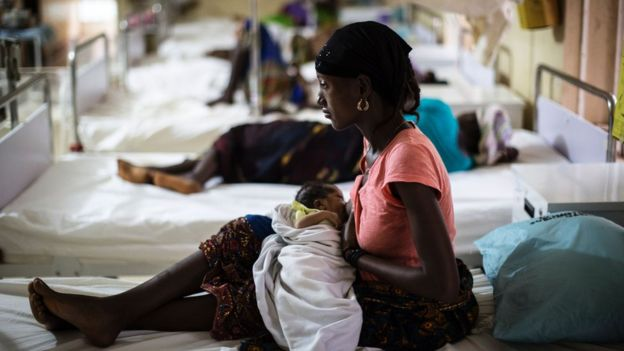 A mother nurses her newborn at the maternity ward of the Kailahun Government hospital on April 26, 2016, eastern Sierra Leone. UNFPA (United Nation Population Fund) supports the local Ministry of Health with a program that promotes maternal health and family planning