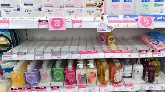 An empty hand sanitiser shelf in Superdrug in London