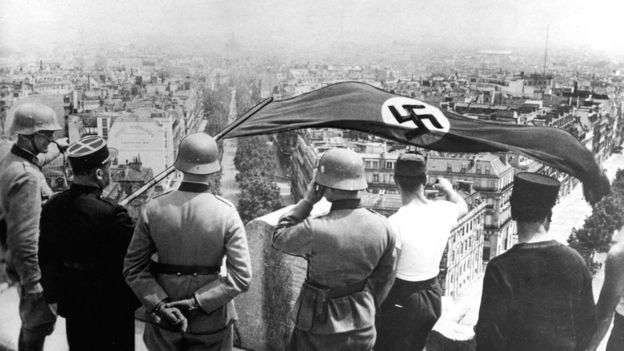 The Nazi flag is flown from the Arc of Triomphe in Paris, June 1940