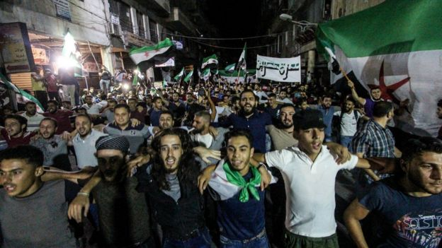 Protesters seen waving the free Syrian flags during an evening demonstration in Idlib City demanding freedom for protocol prisoners imprisoned by the Syrian regime. They are also shouting anti regime slogans and demanding president Assad to step down.