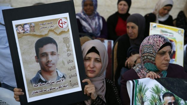 Families of Palestinians imprisoned in Israeli jails demonstrate in front of the Red Cross offices in east Jerusalem on May 17, 2017, as hundreds of the detainees entered the second month of a hunger strike.
