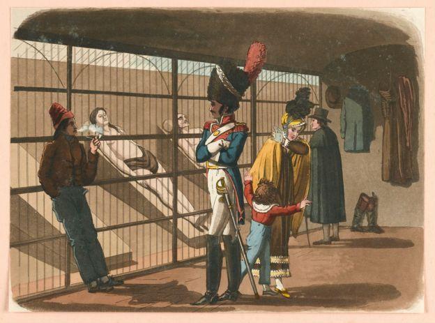 Gente de visita en la morgue de París para ver cadáveres, en esta ilustración de R.B. Peake de 1816.