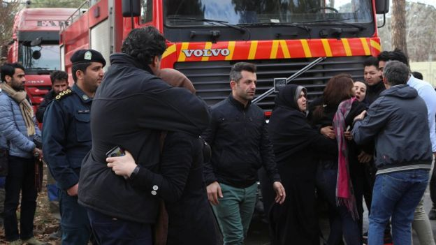Rescue teams at wreckage site near Fath airport in Iran